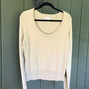 Camel colored scoop necked sweater.
